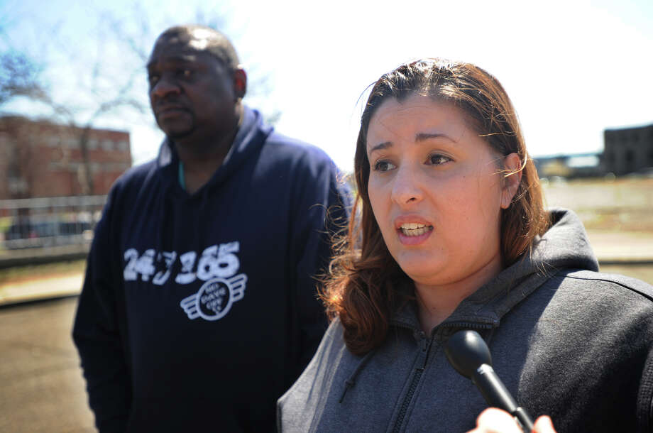 Juvenile detention officers Jennifer Puffen, of Bridgeport, and Travis Smith, of New Haven, speak out about state imposed layoffs outside the Bridgeport Juveline Detention Center in Bridgeport, Conn. on Thursday, April 14, 2016. The state is considering closing the facility which could force the layoff of more than 100 workers at the facility. Photo: Brian A. Pounds / Hearst Connecticut Media / Connecticut Post