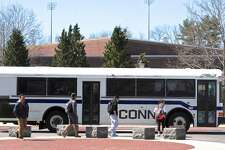 A campus bus picks up students in front of the University of Connecticut student union on Thursday, April 14, 2016, in Storrs, Conn.