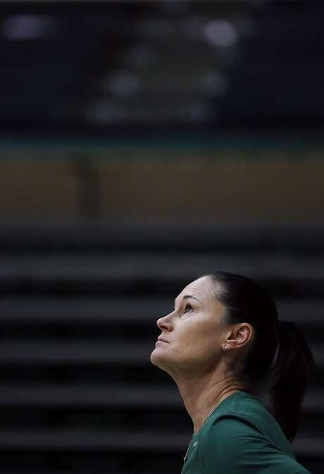 Don's women's basketball head coach Jennifer Azzi watches the ball as it flies towards the basket during an individual workout session at University of San Francisco in the gym April 8, 2016 in San Francisco, Calif. Photo: Leah Millis, The Chronicle