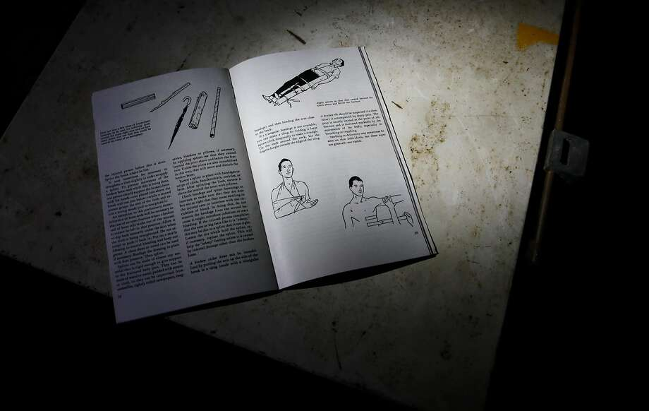 Basic medical books can still be found inside the bomb shelter under the main warehouse building at the old Point Molate Fuel Department. Photo: Michael Macor, The Chronicle