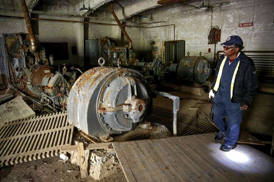 Caretaker Willie Agnew works inside the pump house at the old Point Molate Fuel Department. Photo: Michael Macor, The Chronicle
