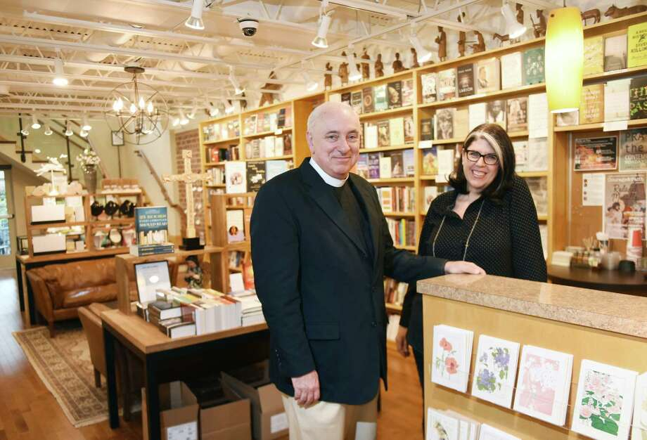 Church Pastor the Rev. Dr. James Lemler and Store Manager Becky Store pose in the newly-expanded Christ Church Bookstore in Greenwich, Conn. Tuesday, April 12, 2016. The bookstore, located inside Christ Church, recently expanded and opened an upstairs addition. The store sells a mix of both faith-based items and books as well as traditional, non-religious books. Photo: Tyler Sizemore / Hearst Connecticut Media / Greenwich Time