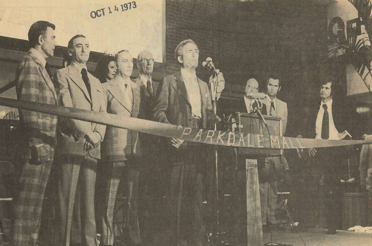 Ben Rogers addresses crowd at Parkdale Mall's opening. Behind him are his three brothers, Sol, Vic and Nate; Judy Mallett, Miss Texas; and Lamar University President Dr. John E. Gray Parkdale Mall opened Oct. 11, 1973.