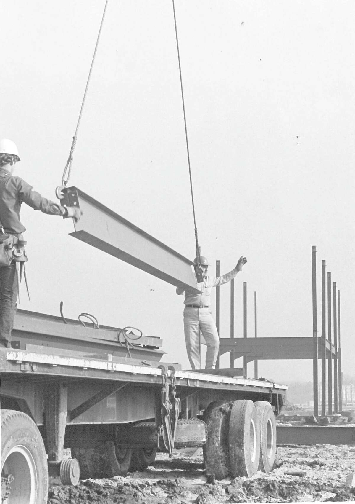 Mike Gravette, left, and Cyril LoBue, ironworkers on Montgomery Ward wing of Parkdale Mall during construction. Photo dated 1972