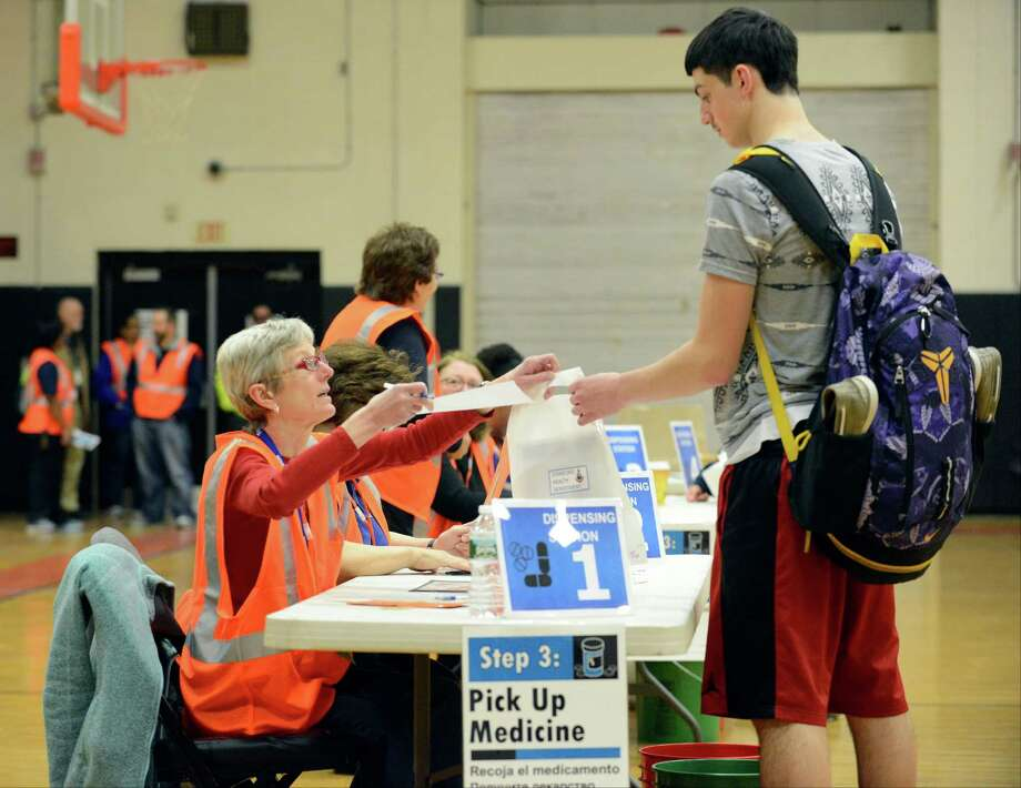 Grace Vetter of Norwalk, a nurse with the Trumbull Health Department, reviews paperwork with participant Tyler Landsiedeo, a student at Stamford High School as The City of Stamford Department of Health and Social Services conduct an emergency response exercise for mass dispensing of oral antibiotics. The drill took place at Stamford High School on April 14, 2016, where a simulated health clinic was set up to handle the 120,000 plus population of Stamford. Photo: Matthew Brown / Hearst Connecticut Media / Stamford Advocate