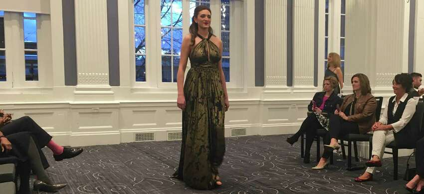 Models walk the runway in the Spring/Summer collection of local designer Daniel Mozzes.