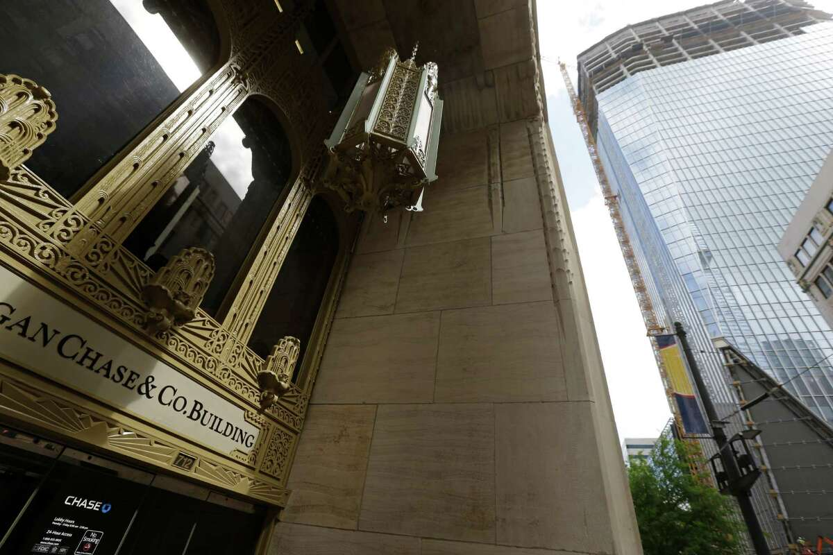 The Gulf Building, 712 Main, is shown on left, as a building, shown right, is under construction at 609 Main Thursday, April 14, 2016, in Houston. Midway and Lionstone announced a redevelopment of the Gulf Building. ( Melissa Phillip / Houston Chronicle )