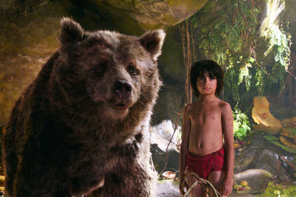 "Baloo (voiced by Bill Murray) and Mowgli (Neel Sethi, right) embark on a journey in ""The Jungle Book."""