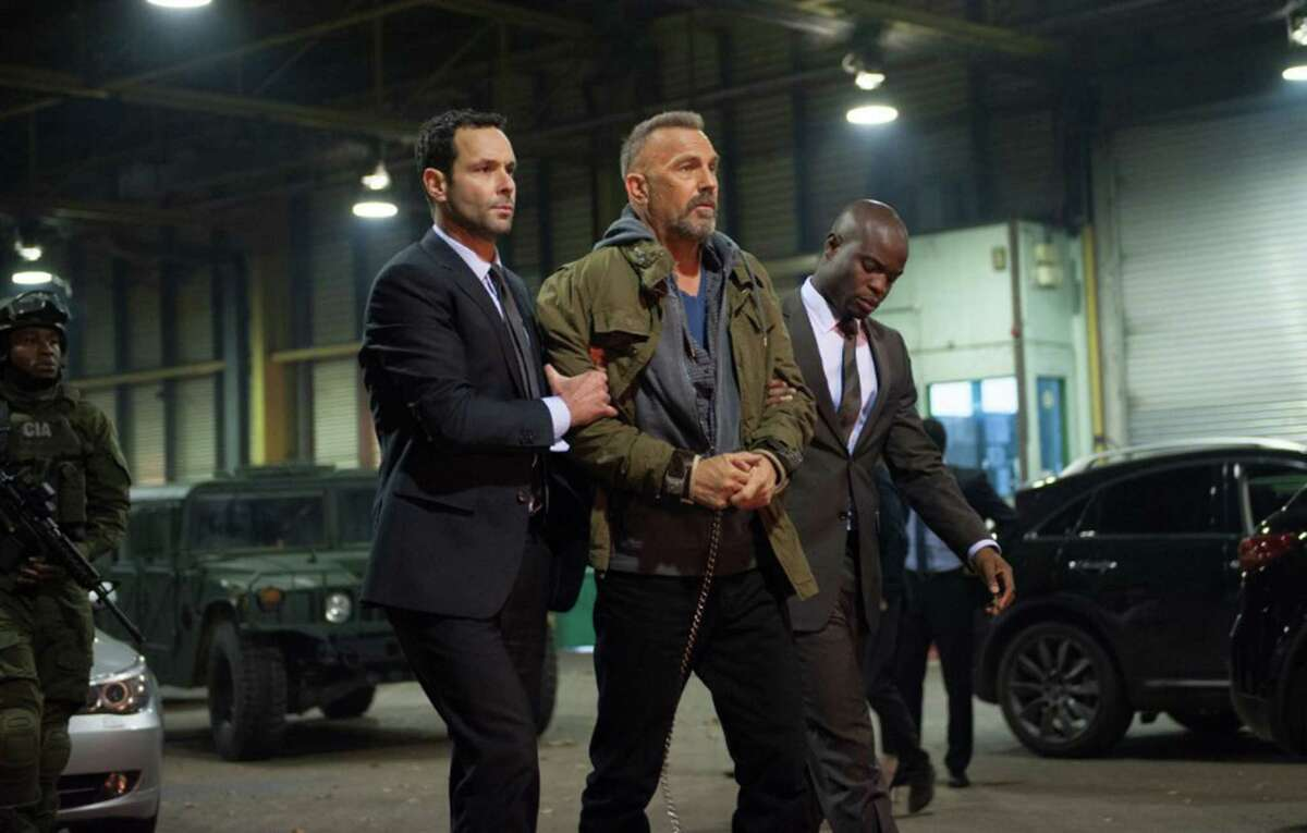 """The CIA puts its hopes for stopping a terror plot in Jericho Stewart (Kevin Costner, center), a death row inmate implanted with a dead agent's memories, in """"Criminal."""""""