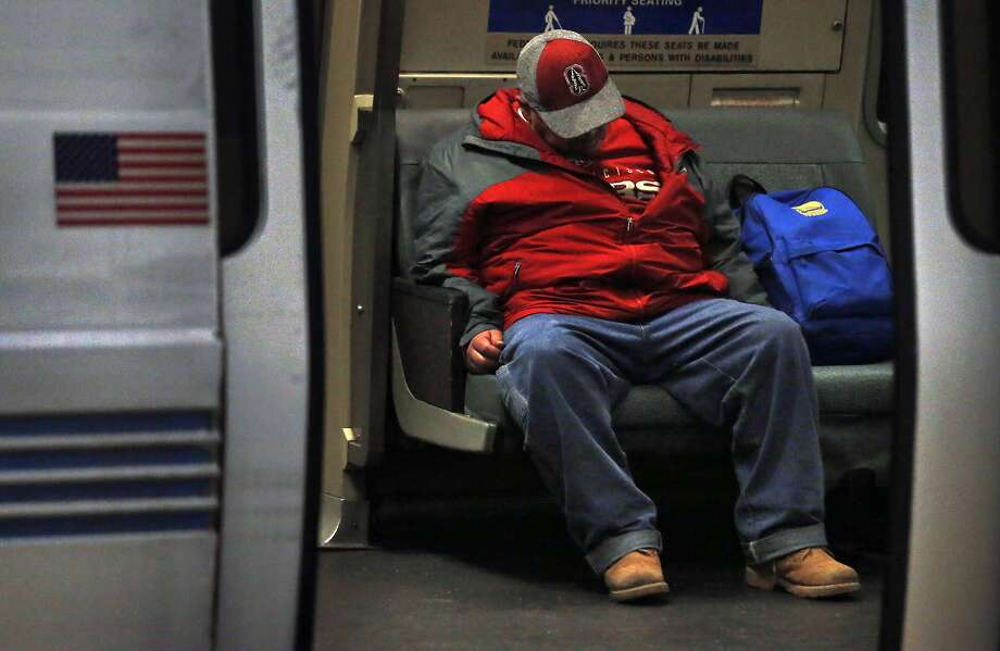 A passenger takes up two seats on a northbound BART train April 14, 2016 in San Francisco, Calif. Photo: Leah Millis, The Chronicle