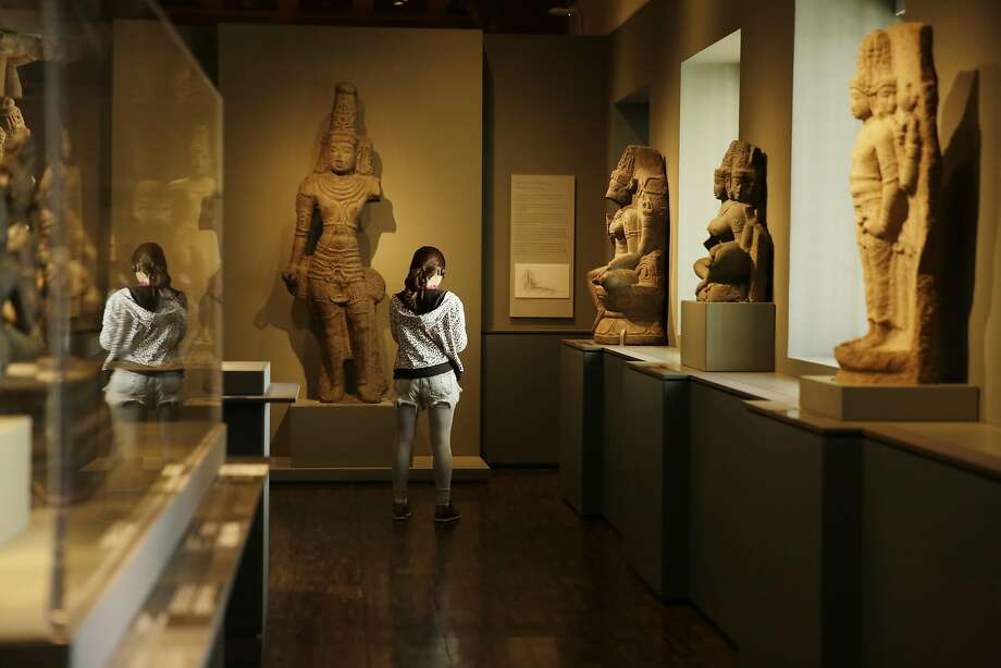 Sally Wang of Fremont takes in the art in a gallery at the Asian Art Museum. Photo: Lea Suzuki, The Chronicle