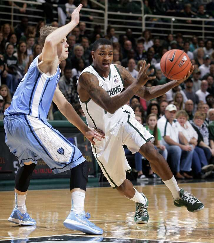 Michigan State's Keith Appling, right, drives against Columbia's Grant Mullins during the first half of an NCAA college basketball game Friday, Nov. 15, 2013, in East Lansing, Mich. (AP Photo/Al Goldis)