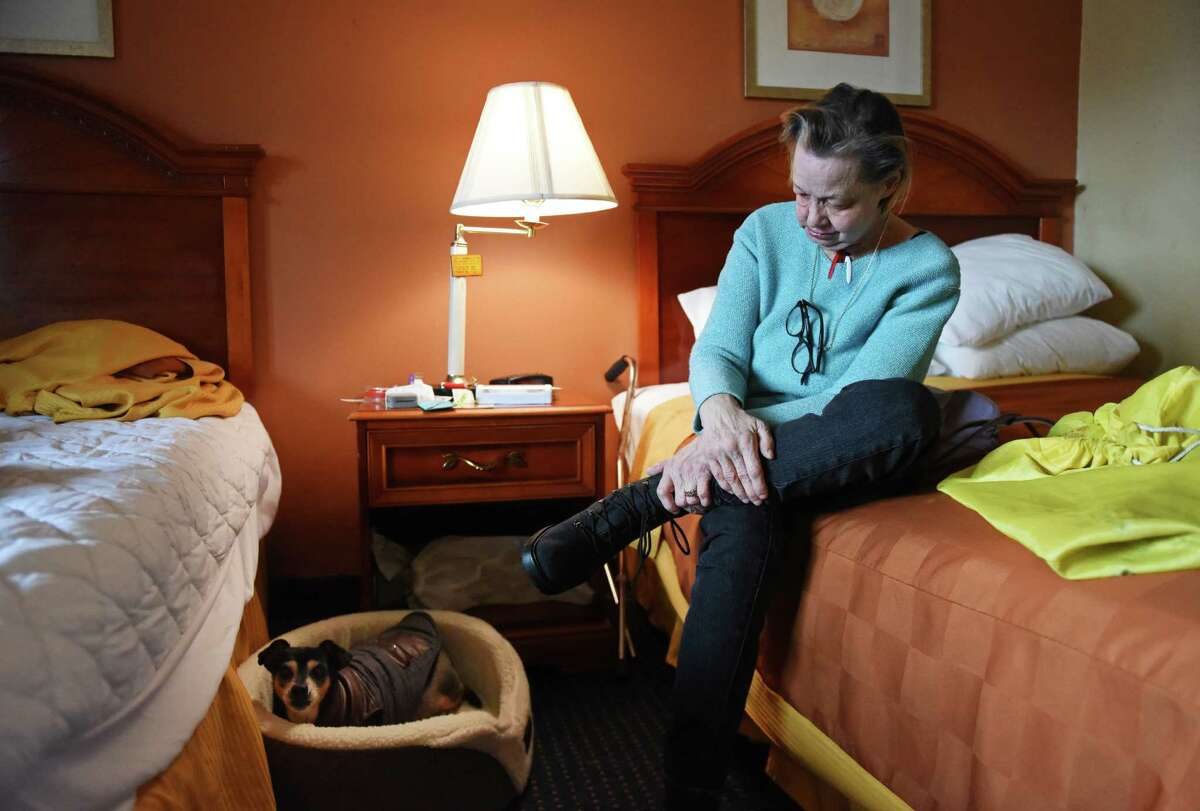 Denise Sadowsky and her dog, Cheeky, in Sadowsky's temporary residence at the Americas Best Value Inn in Stamford, Conn. Monday, April 11, 2016. After breaking her back, Sadowsky lost her job and home and had a falling out with many of her friends and family, leaving Cheeky, her Chihuahua-Dachshund mix, as her most beloved companion. Now, Sadowsky is struggling to find a permanent resident because many apartment complexes and senior living homes do not allow pets, despite Cheeky being labeled as an official service dog.