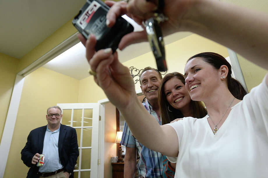 From left, Rob Glassey, Denise Berry, and Natasha Garrett gather together for a photo as they and others socialize at the Beaumont Chamber of Commerce's Mix and Mingle event Thursday night at Forest Lawn Funeral Home and Memorial Park. Photo taken Thursday, April 14, 2016 Kim Brent/The Enterprise Photo: Kim Brent / Beaumont Enterprise