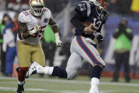 New England Patriots quarterback Tom Brady (12) runs from San Francisco 49ers nose tackle Ricky Jean Francois (95) in the fourth quarter of an NFL football game in Foxborough, Mass., Sunday, Dec. 16, 2012. (AP Photo/Elise Amendola)