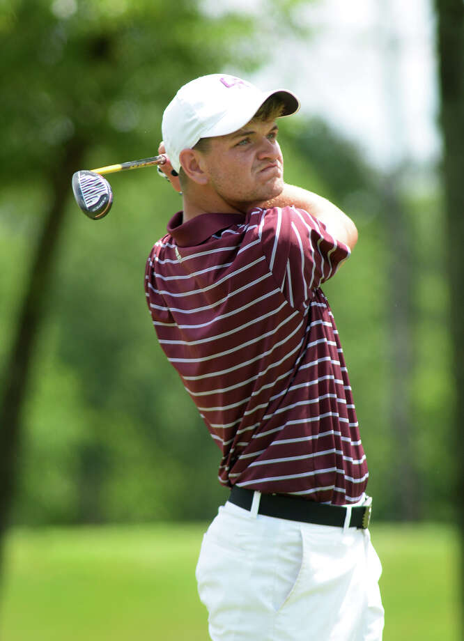 Cinco Ranch's Jared Bray follows his shot on the par 4 16th hole during the final round of the Region III-6A Boys Golf Championship at Eagle Pointe Golf Club in Mont Belvieu on Thursday. (Photo by Jerry Baker/Freelance) Photo: Jerry Baker, For The Houston Chronicle