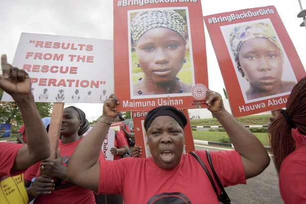 Members of Bring Back Our Girls movement carry plarcards with pictures to press for the release of the missing Chibok schoolgirls in Lagos, Nigeria on Thursday.