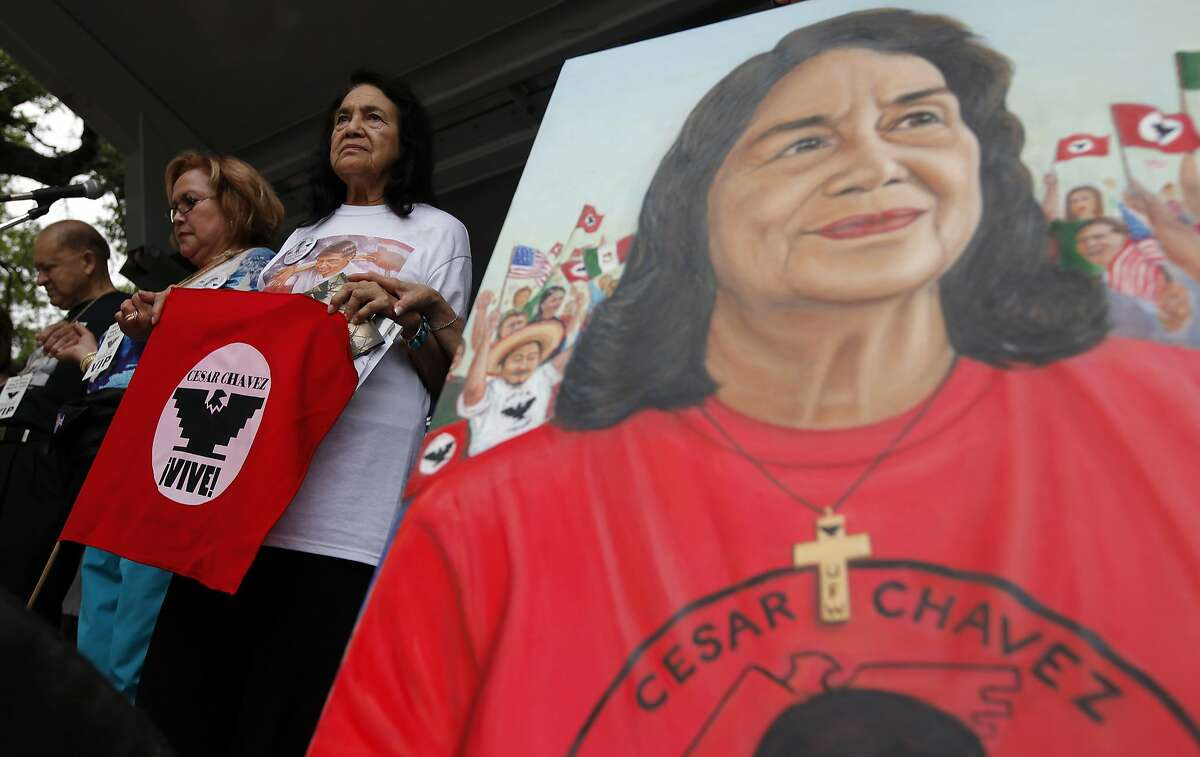 Dolores Huerta stands beside a painting of herself at the 15th annual Cesar Chavez March for Justice on Saturday, Mar. 26, 2011. Huerta is the co-founder of United Farm Workers of America with famed labor rights leader Cesar Chavez. Huerta was the keynote speaker at the event. Kin Man Hui/kmhui@express-news.net