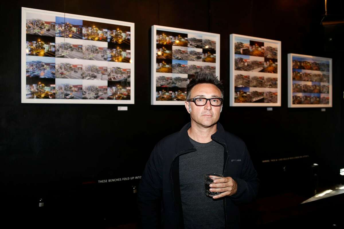 Artist and bar owner Michael Krouse stands in front of a few of the framed photographic collages from his Arco Project hanging on the walls of the Madrone Art Bar in San Francisco, California, on Wednesday, April 13, 2016.