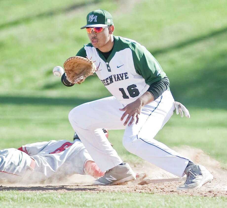 New Milford High School's Noah Martinez takes a pick-off throw at first in a game against Greenwich High School, played at New Milford. Thursday, April 14, 2016 Photo: Scott Mullin / For The / The News-Times Freelance