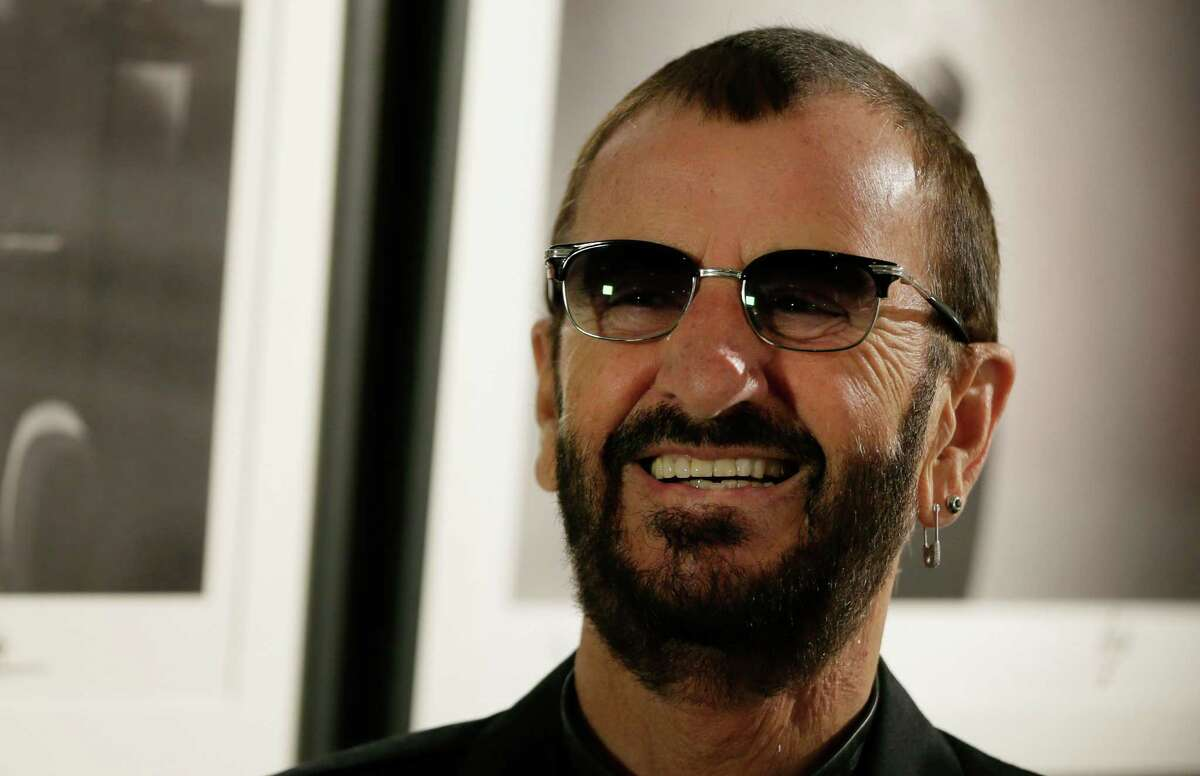 Pop icon and former Beatle Ringo Starr poses for the media in front of some of his photographs during a photocall as he launches a book called