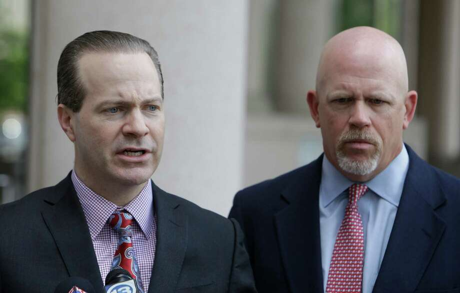 Attorneys Jared Woodfill, left, and Terry Yates, right, say  their client, David Daleiden, should have his record tampering case dismissed. Photo: Melissa Phillip, Staff / © 2016 Houston Chronicle