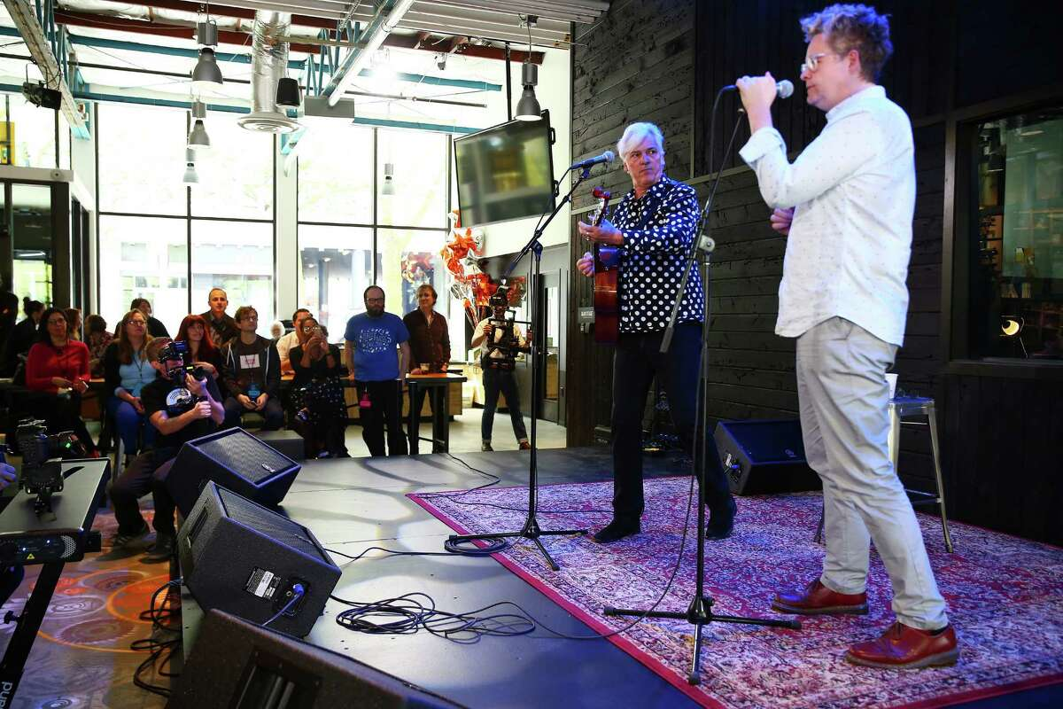 Musicians Robyn Hitchcock and Sean Nelson perform during a pre-opening day event at the new KEXP studio at Seattle Center, Thursday, April 14, 2016. The studio's public grand opening will be held Saturday, April 16.