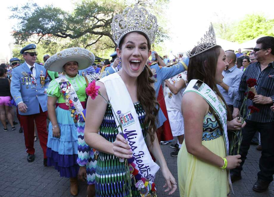 Madi Moad-Hageman, Miss Fiesta San Antonio walks in the flower parade during the official opening of Fiesta 2016 in front of the Alamo on April 14, 2016. Photo: TOM REEL, SAN ANTONIO EXPRESS-NEWS / 2016 SAN ANTONIO EXPRESS-NEWS
