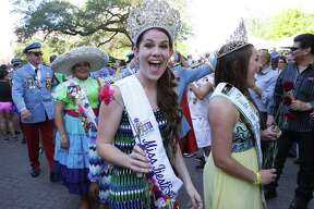 Madi Moad-Hageman, Miss Fiesta San Antonio walks in the flower parade during the official opening of Fiesta 2016 in front of the Alamo on April 14, 2016.
