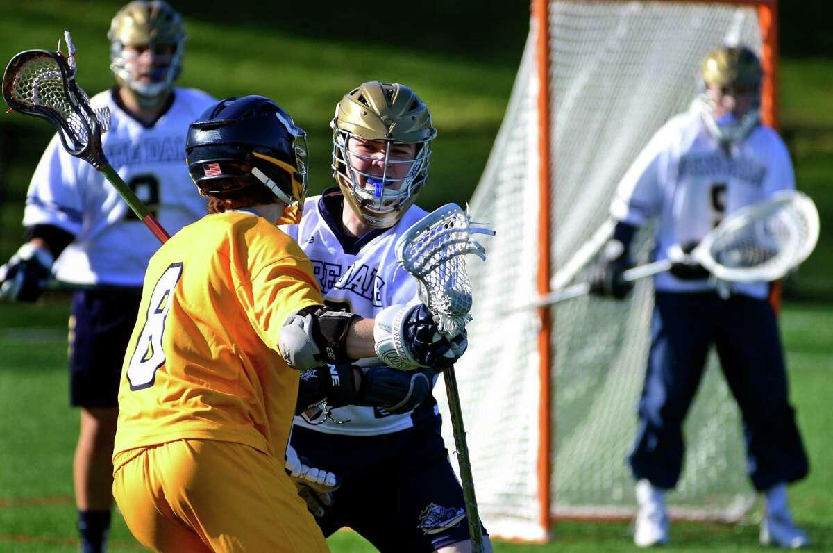 Notre Dame of Fairfield's Andrew Fallon defends the goal as Weston's advances during boys lacrosse action in Bridgeport, Conn., on Thursday Apr. 14, 2016.