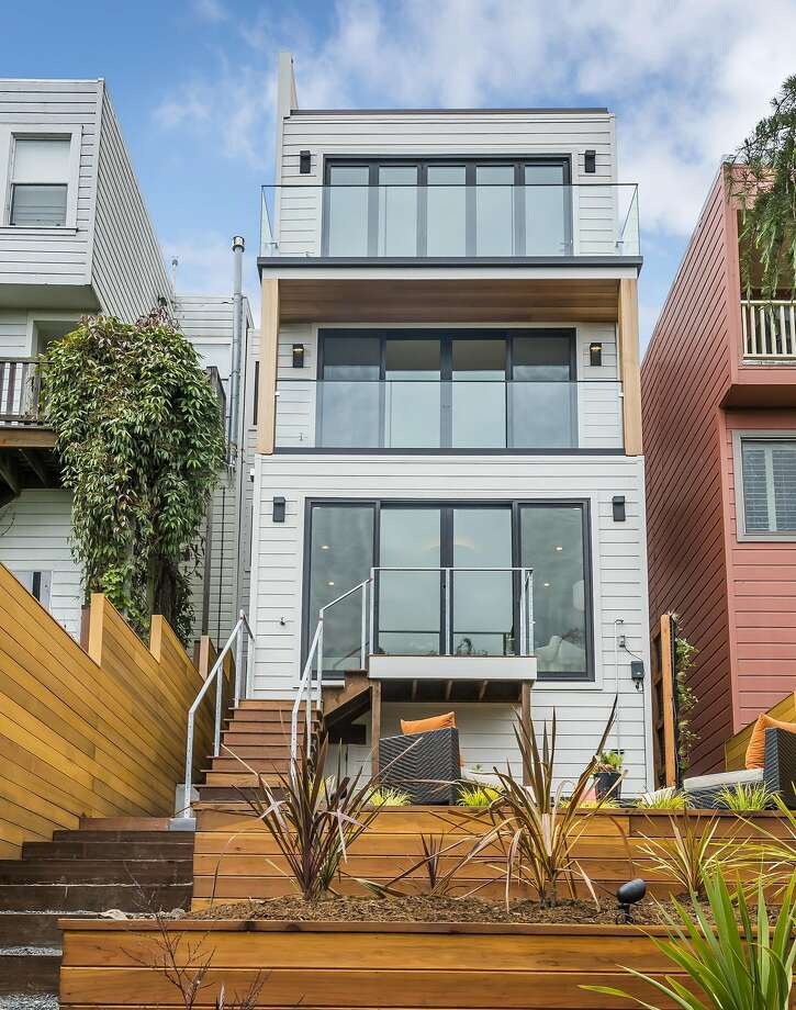 A view from the terraced backyard shows how each of the Potrero Hill home's three levels enjoys an outdoor space. Photo: Olga Soboleva / Vanguard Properties