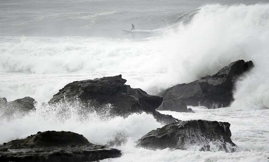 Waves are expected to reach 15 feet in Half Moon Bay this week. Photo: Marcio Jose Sanchez, Associated Press