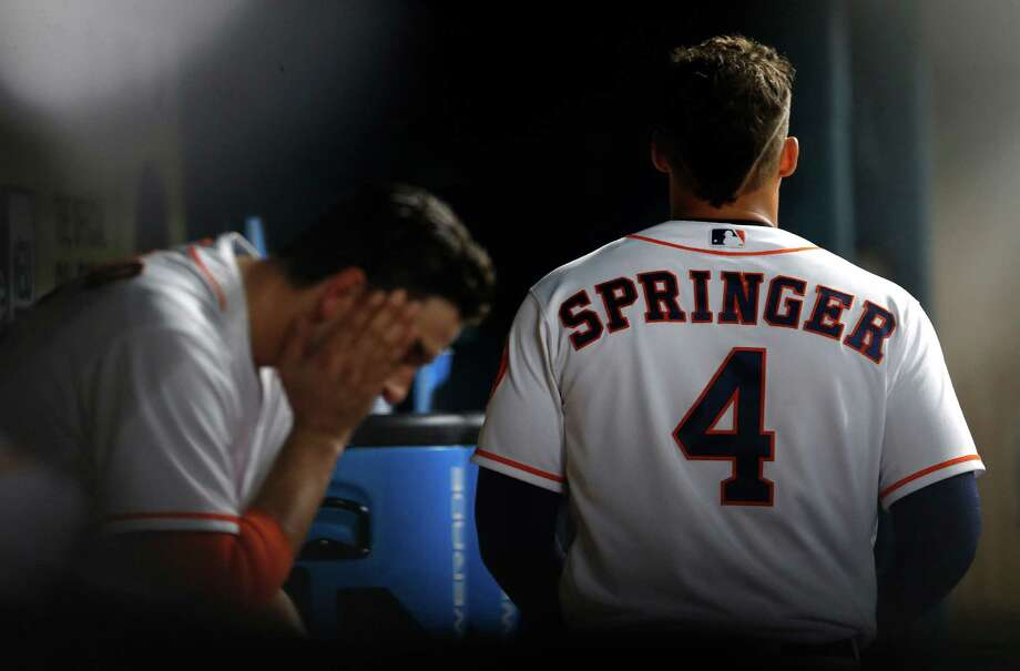 April 14: Royals 6, Astros 2Houston Astros right fielder George Springer (4) walks by Jason Castro in the dugout during the seventh inning of an MLB baseball game at Minute Maid Park, Thursday, April 14, 2016, in Houston. Photo: Karen Warren, Houston Chronicle / © 2016 Houston Chronicle