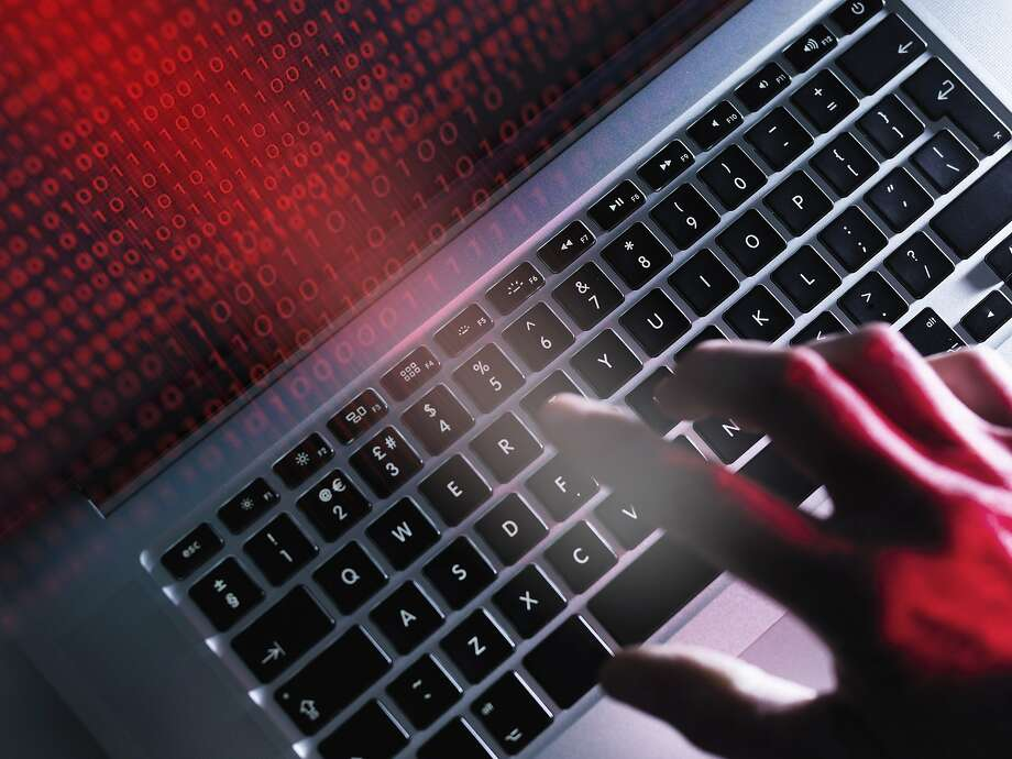 File photo of computer keyboard for cybercrime. Computer being corrupted Photo: Andrew Brookes / Getty Image