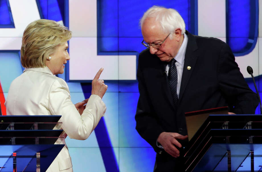 Democratic presidential candidate Hillary Clinton, left, gestures towards Democratic presidential candidate Sen. Bernie Sanders, I-Vt., at the start of a break during the CNN Democratic Presidential Primary Debate at the Brooklyn Navy Yard on Thursday, April 14, 2016 in New York. Photo: Seth Wenig, AP / AP
