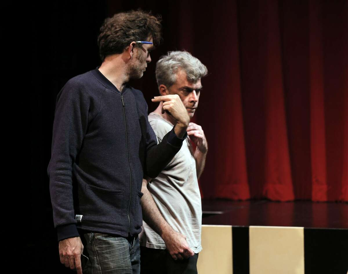 Director Mark Jackson, left, discusses a role with Kevin Clarke, right, during rehearsal for Hamlet at the Shotgun Player in Berkeley, Calif., on Thursday, April 14, 2016. The play uses a roulette technique to decide which actor plays a particular character, where the names are drawn from a container, in this case, Yorick's skull.
