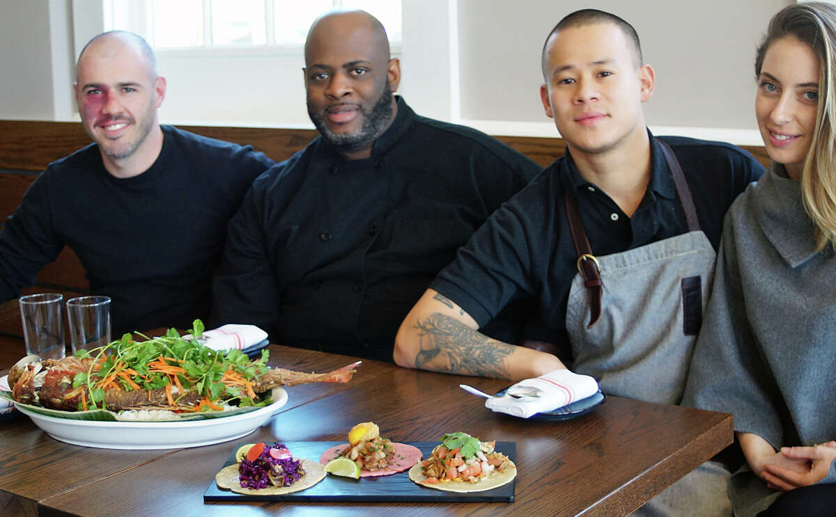 The group behind the new Miro Kitchen, from left, co-owner Eugene Kabilnitsky, Edward McCall, co-executive chef, co-owner and executive chef Chris Gonzalez, and co-owner Nicole Gonzalez.