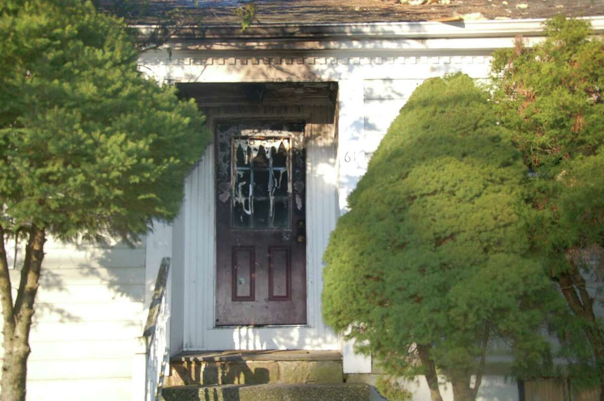 A house at 61 Kenosia Ave. in Danbury was heavily damaged by a fire Thursday night.