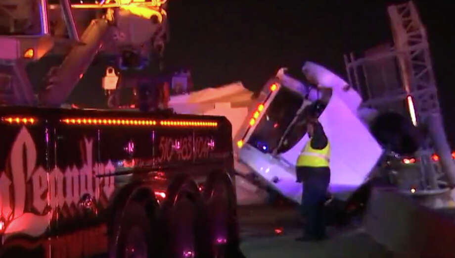 East Bay drivers face a tough morning commute after a big-rig crashed  into the center divide knocking over a freeway sign in Hayward Photo: KTVU