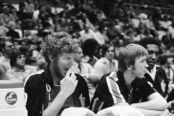 Left: The injuries of Bill Walton (left) ruined the Trail Blazers' repeat chances, but they were still a great team.