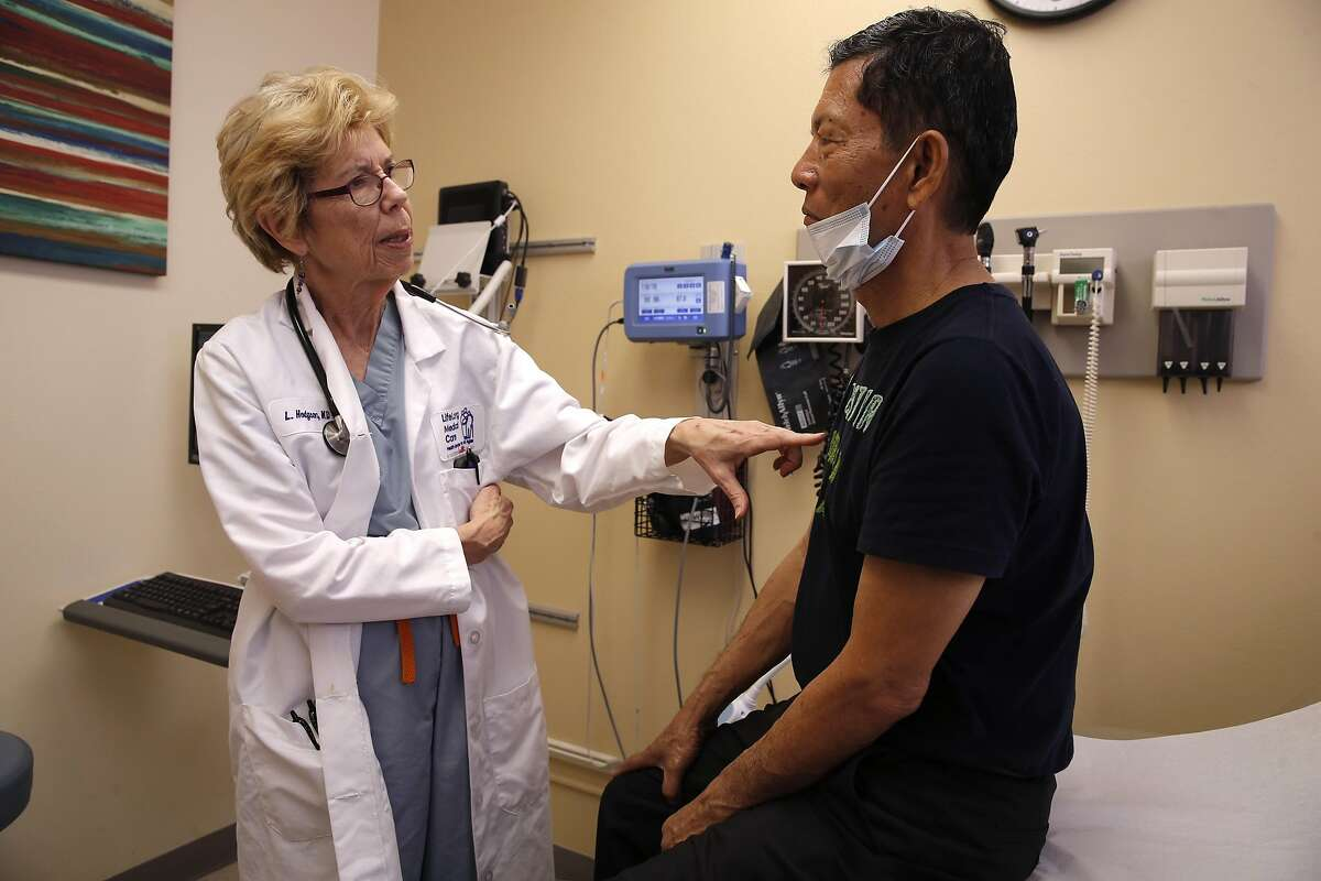 Dr. Laurel Hodgson tends to 68-year-old Augusto Vega, of Hercules at the LifeLong Medical Care an urgent care clinic in San Pablo, California on Thurs. April 14, 2016, is operating across the street from the Doctors Medical Center hospital which closed down a year ago. Dr. Hodgson worked at Doctor Medical Center before it shut down.