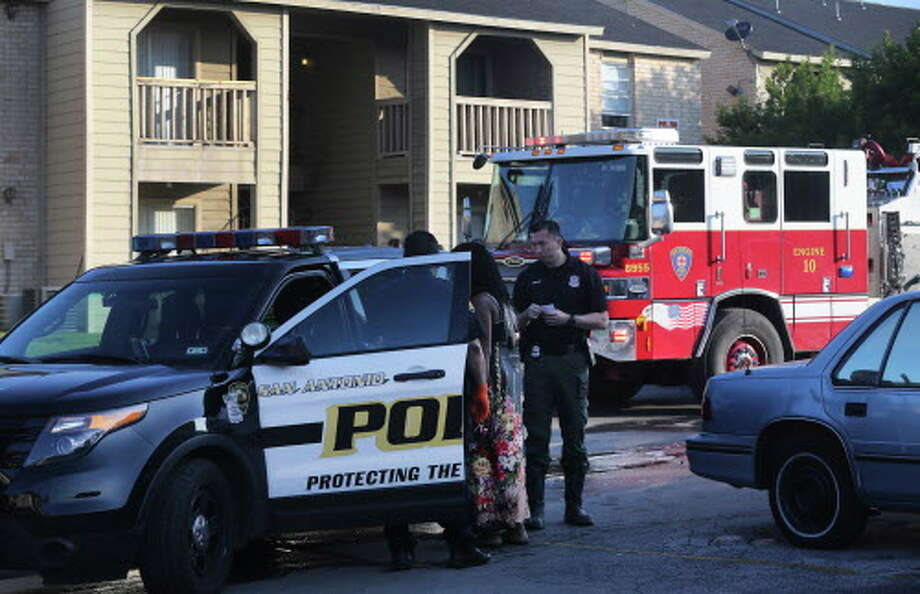 San Antonio police and arson investigate Friday April 15, 2016 at the Fredericksberg Place apartments at 3435 Fredericksberg after a man intentionally set his bed on fire about 7:30 a.m. according to battalion chief Walter Yates. Yates said the man decided to kill himself and later changed his mind and stepped out onto the sidewalk in front of his apartment. The 64-year-old man is being detained while arson investigators look into the matter. There were no injuries and there was about $30,000 in damage to the building Yates said. Photo: John Davenport, San Antonio Express-News / ©San Antonio Express-News/John Davenport