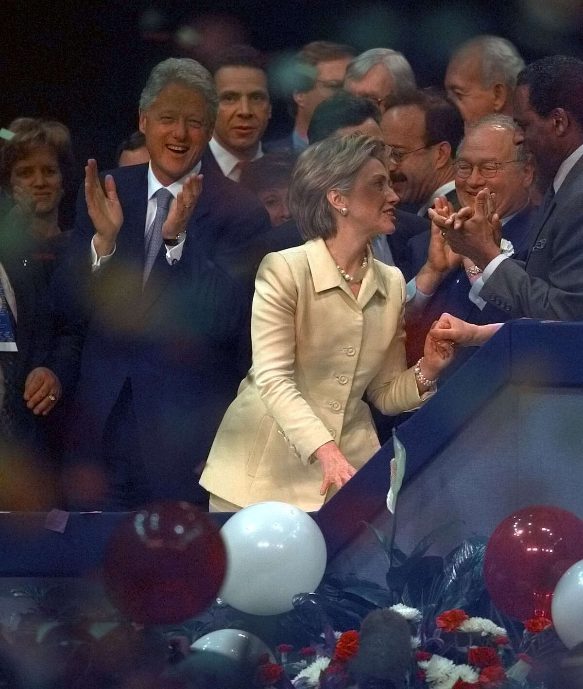 Hillary Clinton celebrates her nomination as Democratic candidate for the US Senate at the state Democratic convention at the Pepsi Arena in Albany Tuesday May 16, 2000. At left is her husband, President Bill Clinton. (Philip Kamrass/Times Union)
