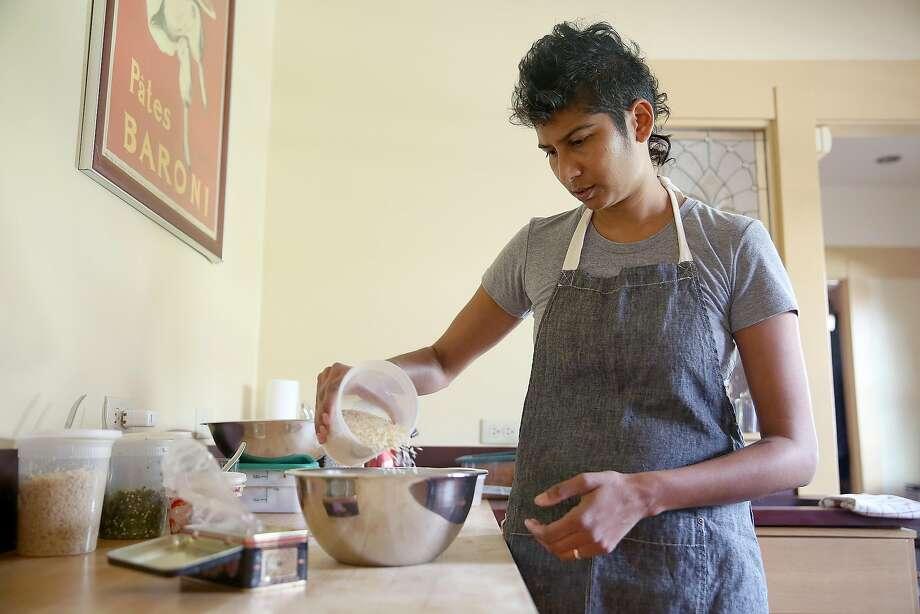 Juhu Beach Club chef Preeti Mistry soaks rice in water at her Oakland home. Photo: Liz Hafalia, The Chronicle