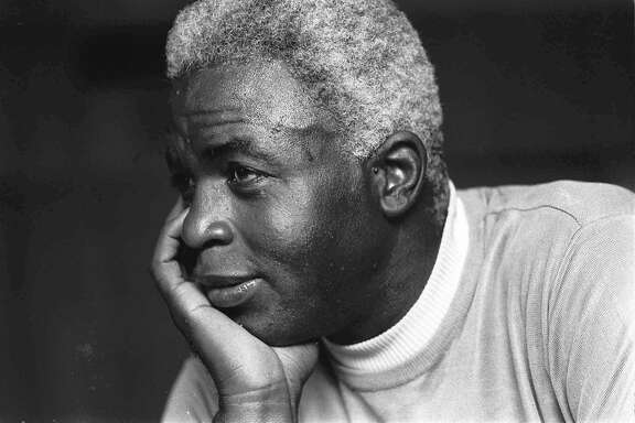 ** FILE ** Jackie Robinson looks pensive at his Stamford, Conn., home, in this June 30, 1971 file photo, as he discusses the death of his son Jack, Jr.(AP Photo) Ran on: 04-13-2007 Jackie Robinson sacrificed to integrate baseball, but African-American players are in short supply in today's game. Ran on: 04-13-2007 Jackie Robinson sacrificed to integrate baseball, but African-American players are in short supply in today's game.  Ran on: 08-08-2010 Jackie Robinson didn't want to manage the Giants in 1960.