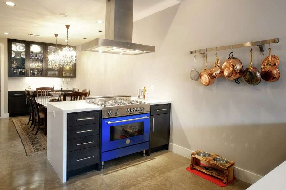 Homeowners may start looking to upgrade their stainless-steel appliances to something that will stand out, such as this vibrant blue oven range. Photo: Courtesy Of On Point Custom Homes