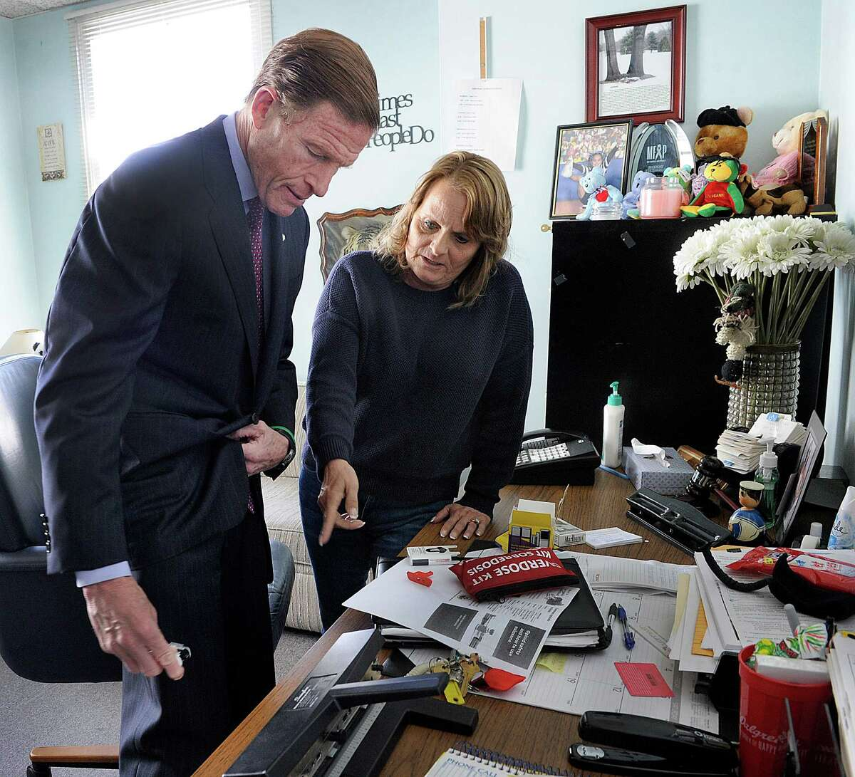 Joanne Montgomery, director of behavior health services at the AIDS Project Greater Danbury, explained the use of a Nalaxone Narcan auto injector to U.S. Sen. Richard Blumenthal during a visit to the AIDS Project in Danbury last month.