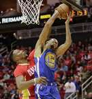 HOUSTON, TX - DECEMBER 31:  Dwight Howard #12 of the Houston Rockets blocks the shot attempt by Shaun Livingston #34 of the Golden State Warriors at Toyota Center on December 31, 2015 in Houston, Texas. NOTE TO USER: User expressly acknowledges and agrees that, by downloading and or using this Photograph, User is consenting to the terms and conditions of the Getty Images License Agreement. Mandatory Copyright Notice: Copyright 2015 NBAE  (Photo by Bob Levey/Getty Images)