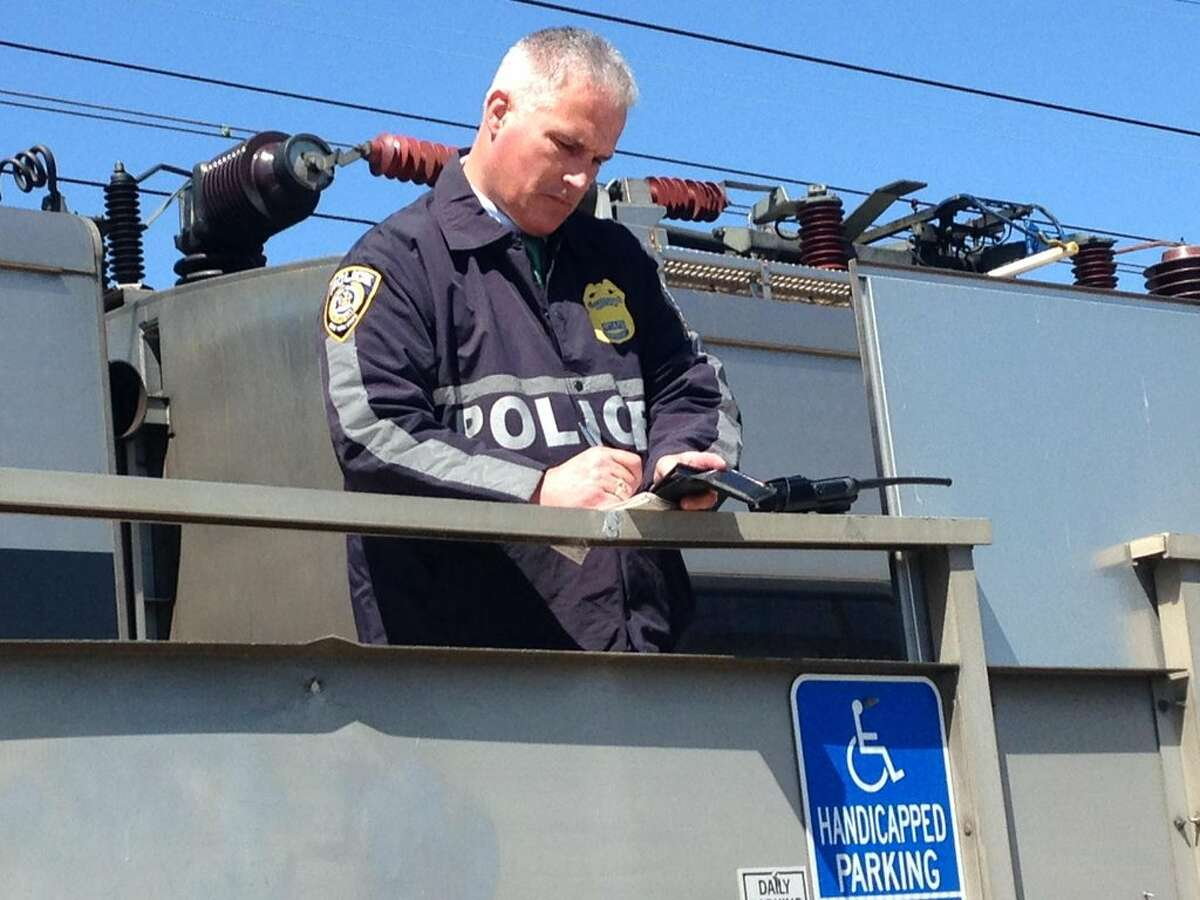 A Metropolitan Transit Authory police officer at the scene in Stratford when a Metro-North train struck and killed a man on Friday, April 15, 2016.