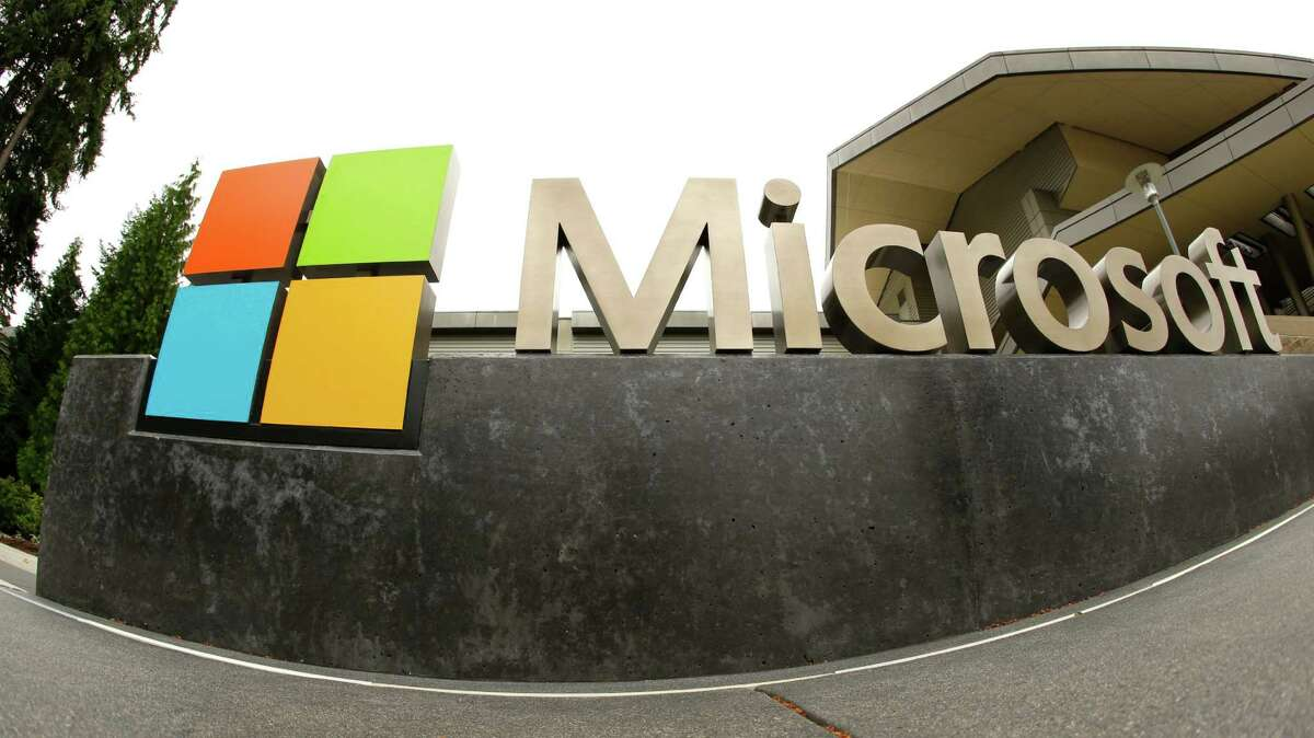 FILE - This July 3, 2014, file photo, shows the Microsoft Corp. logo outside the Microsoft Visitor Center in Redmond, Wash. In a lawsuit filed Thursday, April 14, 2016, Microsoft is suing the U.S. government over a federal law that lets authorities examine its customers?' email or online files without the customers?' knowledge. The lawsuit comes as the tech industry is increasingly butting heads with U.S. officials over customers?' privacy rights. (AP Photo Ted S. Warren, File)